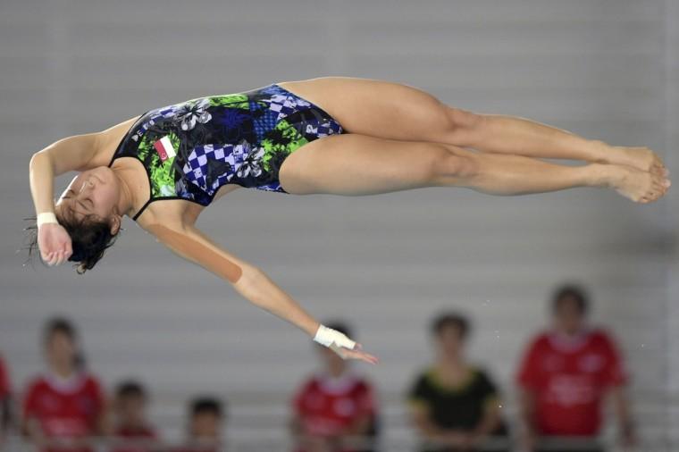 Frieda Lim of Singapore dives in the women's 10-meter platform final at the SEA Games in Singapore Tuesday, June 9, 2015.(AP Photo/Joseph Nair)