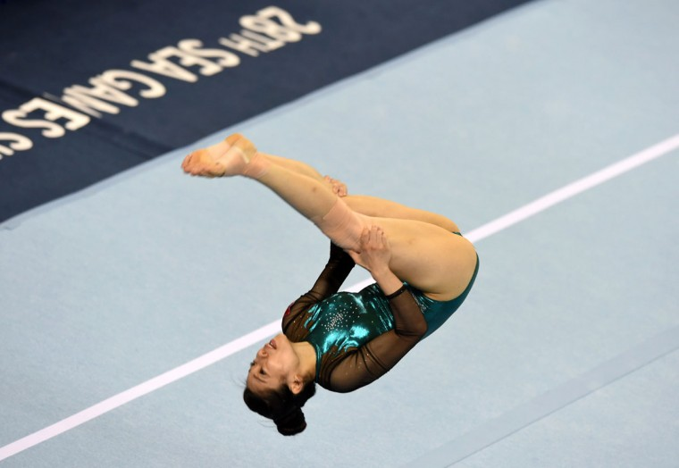 Vietnam's PhanThi Ha Thanh competes on the floor exercise during the women's individual all-around gymnastics final at the 28th Southeast Asian Games (SEA Games) in Singapore on June 8, 2015. (ROSLAN RAHMAN/AFP/Getty Images)