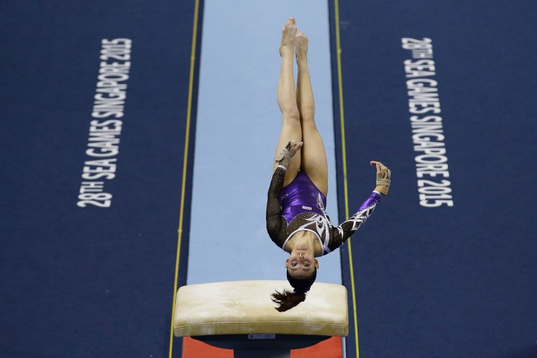 Farah Ann Abdul Hadi of Malaysia in action during the vault event in the women's gymnastic individual all-around final at the Bishan Sports Hall during the 2015 SEA Games on June 8, 2015 in Singapore. (Photo by Suhaimi Abdullah/Getty Images)