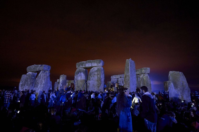 Revellers celebrate the pagan festival of Summer Solstice at Stonehenge in Wiltshire, southern England on June 21, 2015. The festival, which dates back thousands of years, celebrates the longest day of the year when the sun is at its maximum elevation. Modern druids and people gather at the landmark Stonehenge every year to see the sun rise on the first morning of summer. (NIKLAS HALLE'N/AFP/Getty Images)