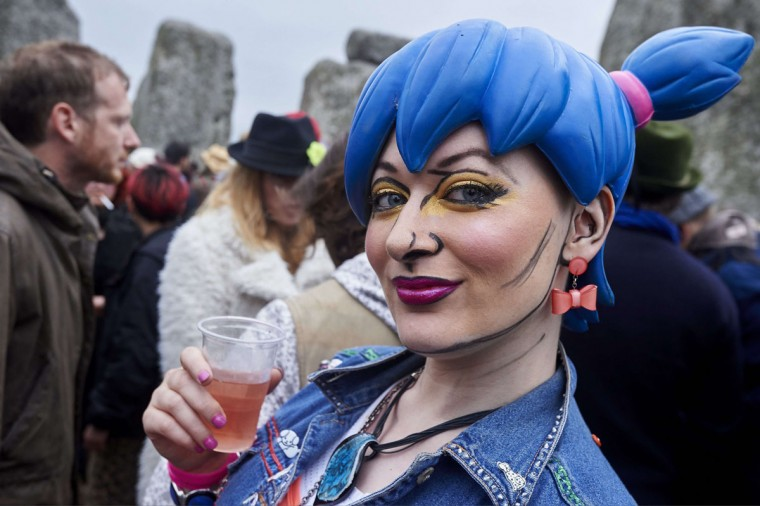 A reveler looks on as she and others celebrate the pagan festival of Summer Solstice at Stonehenge in Wiltshire, southern England on June 21, 2015. The festival, which dates back thousands of years, celebrates the longest day of the year when the sun is at its maximum elevation. Modern druids and people gather at the landmark Stonehenge every year to see the sun rise on the first morning of summer. (NIKLAS HALLE'N/AFP/Getty Images)