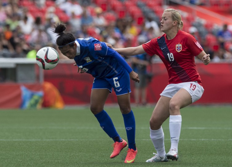 Thailand's Pikul Khueanpet heads the ball in front of Norway's Kristine Minde during a Group B match at the 2015 FIFA Women's World Cup at Landsdowne Stadium in Ottawa on June 7, 2015. (NICHOLAS KAMM/AFP/Getty Images)