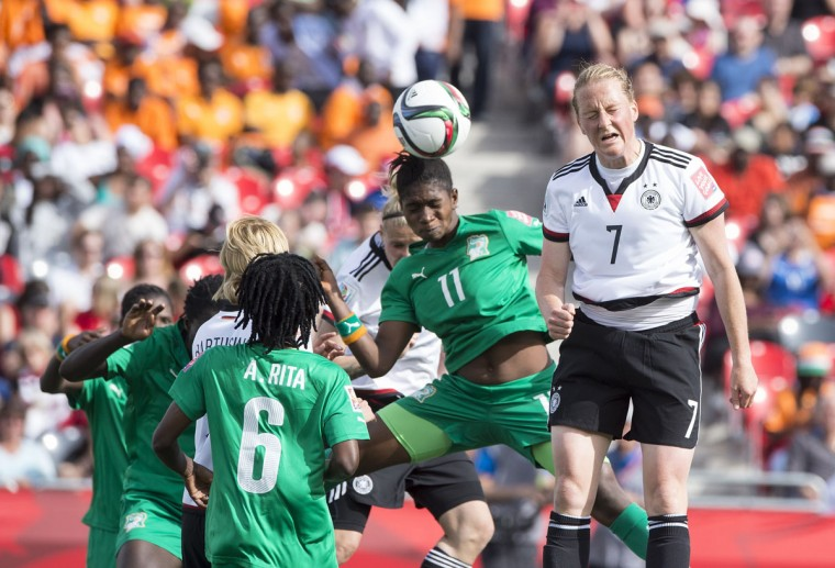 Ivory Coast's Rebecca Elloh and Germany's Melanie Behringer head the ball during a Group B match at the 2015 FIFA Women's World Cup at Landsdowne Stadium in Ottawa on June 7, 2015. (NICHOLAS KAMM/AFP/Getty Images)