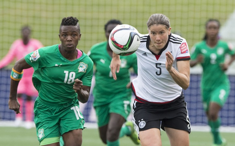 Germany's Annike Krahn and Ivory Coast's Binta Diakite fight for the ball during a Group B match against Germany at the 2015 FIFA Women's World Cup at Landsdowne Stadium in Ottawa on June 7, 2015. (NICHOLAS KAMM/AFP/Getty Images)