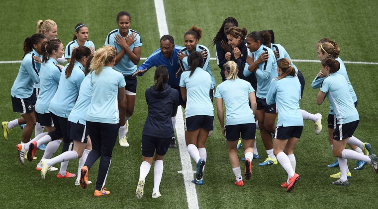 France's players warm up during a training session at the Moncton Stadium on June 8, 2015 in Mocton, New Brunswick, Canada on the eve of France's 2015 FIFA Women's World Cup group F football match against England. (FRANCK FIFE/AFP/Getty Images)