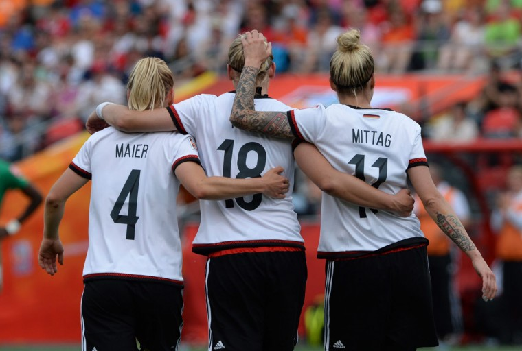 Germany's Leonie Maier, left to right, Alexandra Popp, and Anja Mittag celebrate a goal as they take on Ivory Coast during FIFA Women's World Cup soccer action in Ottawa, Ontario, Sunday, June 7, 2015. (Sean Kilpatrick/The Canadian Press via AP)