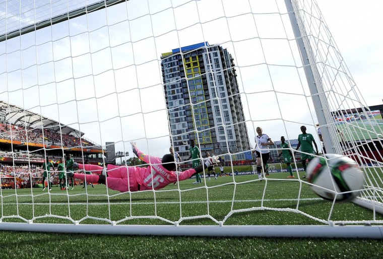 The ball enters the net behind Ivory Coast's goaltender Dominique Thiamale after a shot by Germany's Alexandra Popp during second half FIFA Women's World Cup soccer action in Ottawa, Ontario on Sunday, June 7, 2015. (Justin Tang/The Canadian Press via AP)