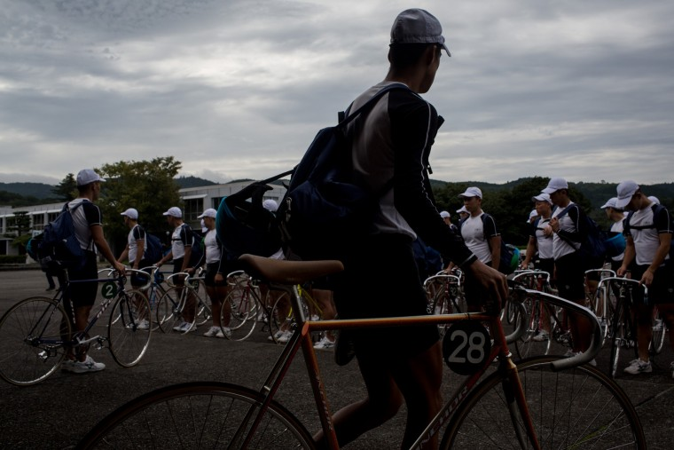 Keirin students walk with their bikes to training at the Nihon Keirin Gakkou (Japan Keirin School) on July 8, 2015 in Izu, Japan. (Photo by Chris McGrath/Getty Images)