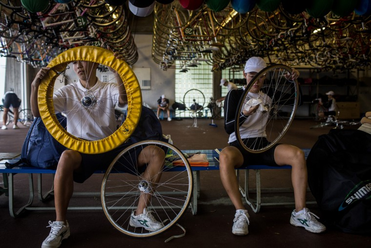 Keirin students clean their bikes at the end of the day after training at the Nihon Keirin Gakkou (Japan Keirin School) on July 8, 2015 in Izu, Japan. (Photo by Chris McGrath/Getty Images)