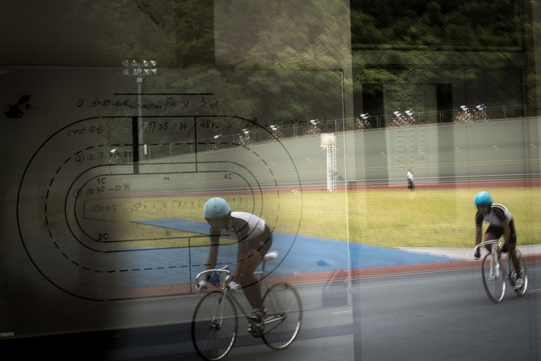 Keirin students are reflected in the days training schedule at the Nihon Keirin Gakkou (Japan Keirin School) on July 8, 2015 in Izu, Japan. (Photo by Chris McGrath/Getty Images)