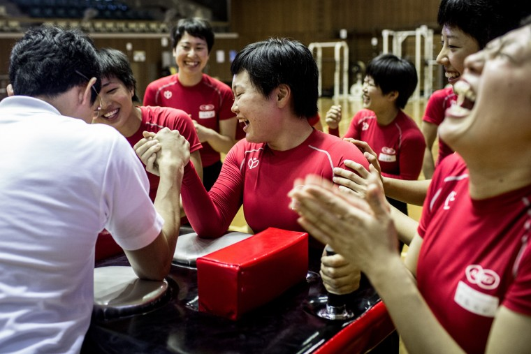 IZU, JAPAN - JULY 08: Female keirin students laugh after an arm wrestling match against their teacher during training at the Nihon Keirin Gakkou (Japan Keirin School) on July 8, 2015 in Izu, Japan. (Photo by Chris McGrath/Getty Images)