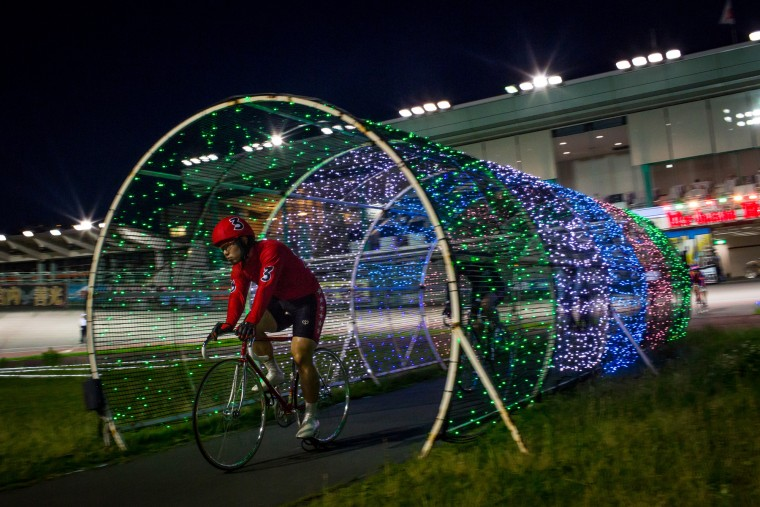A rider enters the velodrome ahead of his race during Keirin races at Kawasaki Velodrome on July 11, 2015 in Kawasaki, Japan. (Photo by Chris McGrath/Getty Images)