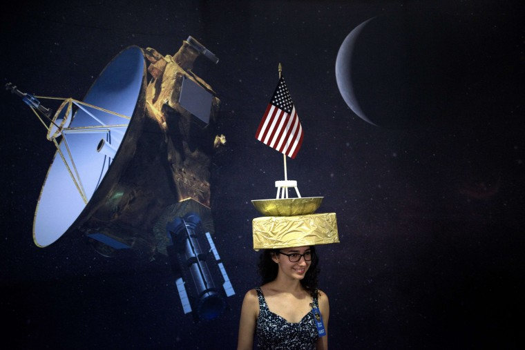 Tara Kedia poses wearing a New Horizons probe hat at the Johns Hopkins University Applied Physics Laboratory July 14, 2015 in Laurel (AFP PHOTO/BRENDAN SMIALOWSKIBRENDAN SMIALOWSKI/AFP/Getty Images)