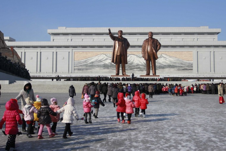 July 8, 1994: Kim Il-Sung, father of Kim Jong-il and former ruler of North Korea, dies, allowing Jong-il to take over. Statues of both are seen in this Dec. 2014 file photo in Pyongyang. (AP file photo)