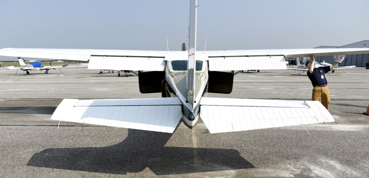 Derward Brooks, of North Laurel, checks over the single-engine Cessna plane he will fly for Angel Flight East on Wednesday, June 10, 2015 at BWI Airport. Brooks does not own the plane, but rents it and pays for the fuel for all Angel Flight missions, which take patients with serious illnesses to places where they can get the treatment they need. (Jon Sham/Baltimore Sun)