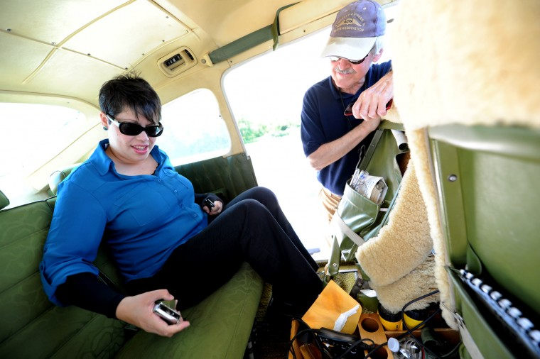 Marleene DeNardo, of Sylva, N.C., left, buckles herself into the back of the single-engine Cessna plane, flown by Derward Brooks, right, before departing Philadelphia and flying to Lynchvurg, Va. on Wedneday, June 10, 2015. Brooks says he enjoys the personal aspect of taking patients on Angel Flight trips because they are often very appreciative. (Jon Sham/Baltimore Sun)