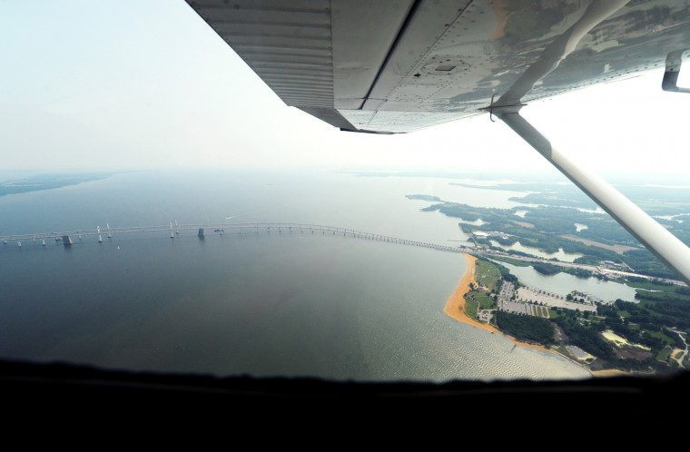 The Chesapeake Bay Bridge can be seen from inside the single-engine Cessna being flown by pilot Derward Brooks, of North Laurel, and co-pilot Larry Esser, of Glen Burnie, as they return to BWI Airport on Wednesday, June 10, 2015. (Jon Sham/Baltimore Sun)