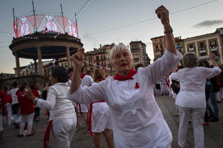 Revelers take part in the traditional 'EL Baile de la Era' (Plot Dance) on the third day of the San Fermin Running of the Bulls festival in Pamplona, Spain. The annual Fiesta de San Fermin, made famous by the 1926 novel of US writer Ernest Hemingway entitled 'The Sun Also Rises', involves the daily running of the bulls through the historic heart of Pamplona to the bull ring. (David Ramos/Getty Images)