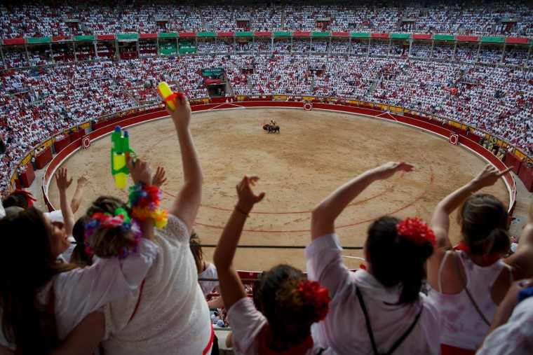 Revelers enjoy the atmosphere inside Pamplona's bullring during a bullfight on the third day of the San Fermin Running Of The Bulls festival on July 8, 2015 in Pamplona, Spain. The annual Fiesta de San Fermin, made famous by the 1926 novel of US writer Ernest Hemingway entitled 'The Sun Also Rises', involves the daily running of the bulls through the historic heart of Pamplona to the bull ring. (Pablo Blazquez Dominguez/Getty Images)