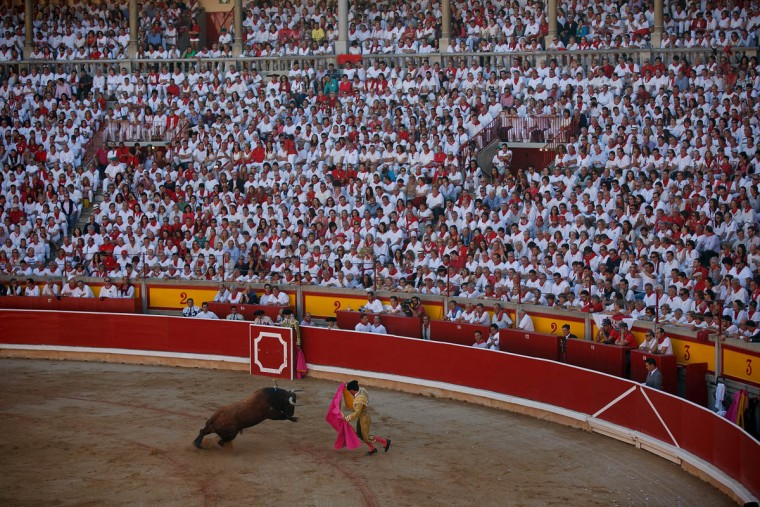 Bullfighter Morenito Aranda performs during a bullfight on the third day of the San Fermin Running Of The Bulls festival on July 8, 2015 in Pamplona, Spain. The annual Fiesta de San Fermin, made famous by the 1926 novel of US writer Ernest Hemingway entitled 'The Sun Also Rises', involves the daily running of the bulls through the historic heart of Pamplona to the bull ring. (Pablo Blazquez Dominguez/Getty Images)