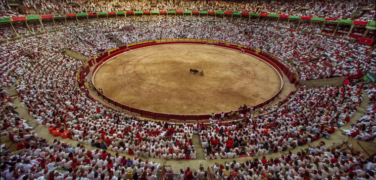 Jimenez Fortes performs with a bull during a bullfight at the San Fermin festival in Pamplona, Spain. (Andres Kudacki/AP photo)