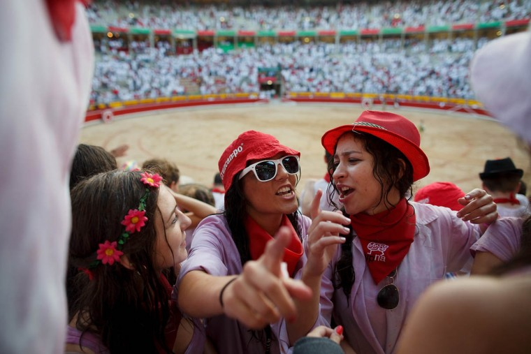 Revelers enjoy the atmosphere inside Pamplona's bullring during a bullfight on the third day of the San Fermin Running Of The Bulls festival. (Pablo Blazquez Dominguez/Getty Images)