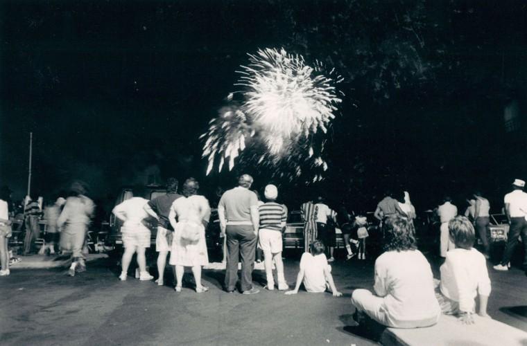 Spectators on the Inner Harbor's south shore observe the fireworks. (Patrick Lim/Baltimore Sun)