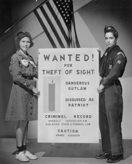 Boy and Girl Scouts, like Cecelia Keech and Lee Goldman, will join the Maryland Society for the Prevention of Blindness this Fourth of July in observing and helping others observe State and Federal fireworks laws. (Baltimore Sun archives, 1955)