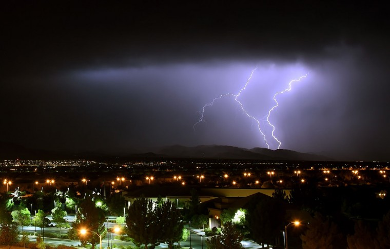 Lightning flashes in the Spring Mountains National Recreation Area during a thunderstorm on July 2, 2015 west of Las Vegas, Nevada. Several rounds of storms swept though the Las Vegas Valley providing some relief from what was the hottest June ever on record in Las Vegas according to the National Weather Service. (Photo by Ethan Miller/Getty Images)