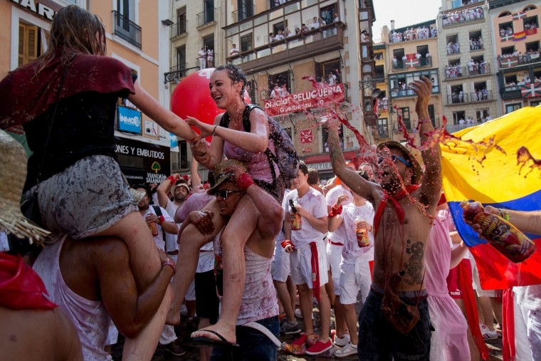 Revellers enjoy the atmosphere during the opening day or 'Chupinazo' of the San Fermin Running of the Bulls fiesta on July 6, 2015 in Pamplona, Spain. The annual Fiesta de San Fermin, made famous by the 1926 novel of US writer Ernest Hemingway entitled 'The Sun Also Rises', involves the daily running of the bulls through the historic heart of Pamplona to the bull ring. (Photo by Pablo Blazquez Dominguez/Getty Images)