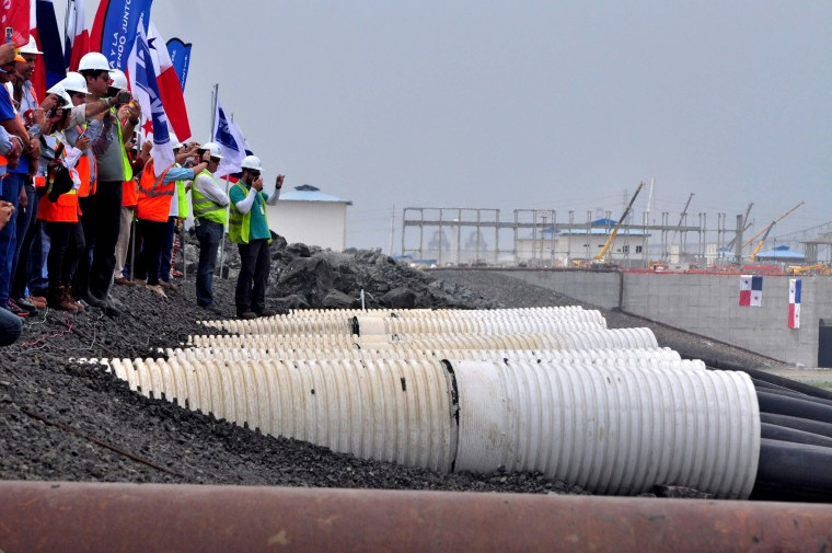 Workers of the Panama Canal observe as the water of the Miraflores Lake goes through the piping of the new locks in Cocoli, 7 km from Panama City on June 22, 2015. The last lock of the new Panama Canal started to be filled Monday as the equipment is ready to be tested before its launch on 2016. (Ed Grimaldo/AFP/Getty Images)