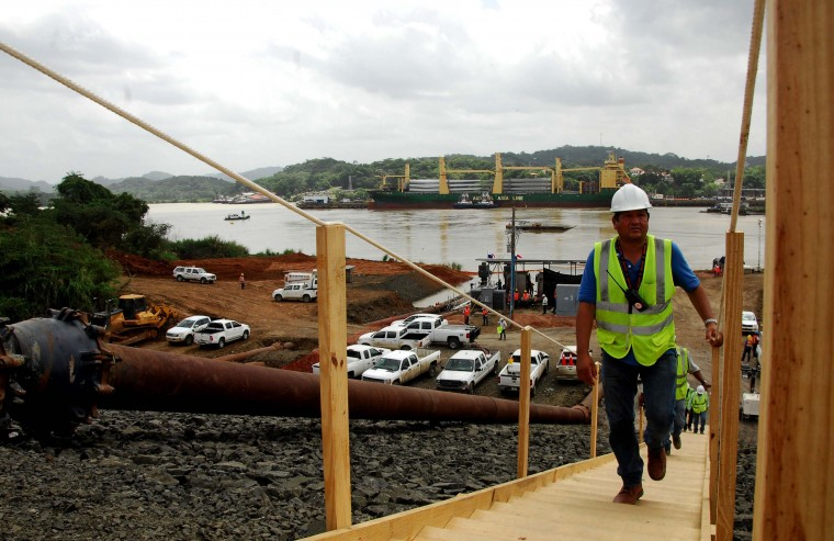Workers go up the stairs as the water of the Miraflores Lake goes through the piping of the new locks in Cocoli, 7 km from Panama City on June 22, 2015. The last lock of the new Panama Canal started to be filled Monday as the equipment is ready to be tested before its launch on 2016. (Ed Grimaldo/AFP/Getty Images)