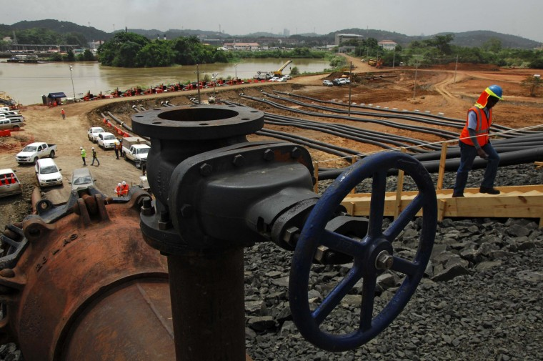 A worker goes up the stairs as the water of the Miraflores Lake goes through the piping of the new locks in Cocoli, 7 km from Panama City on June 22, 2015. The last lock of the new Panama Canal started to be filled Monday as the equipment is ready to be tested before its launch on 2016. (Ed Grimaldo/AFP/Getty Images)