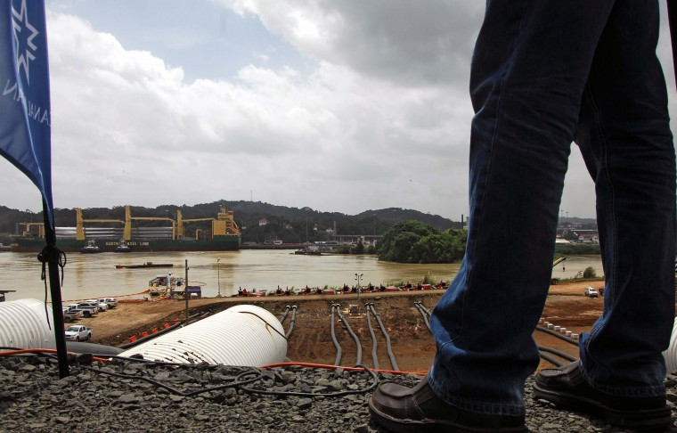 A man looks as the water of the Miraflores Lake goes through the piping of the new locks in Cocoli, 7 km from Panama City on June 22, 2015. The last lock of the new Panama Canal started to be filled Monday as the equipment is ready to be tested before its launch on 2016. (Ed Grimaldo/AFP/Getty Images)