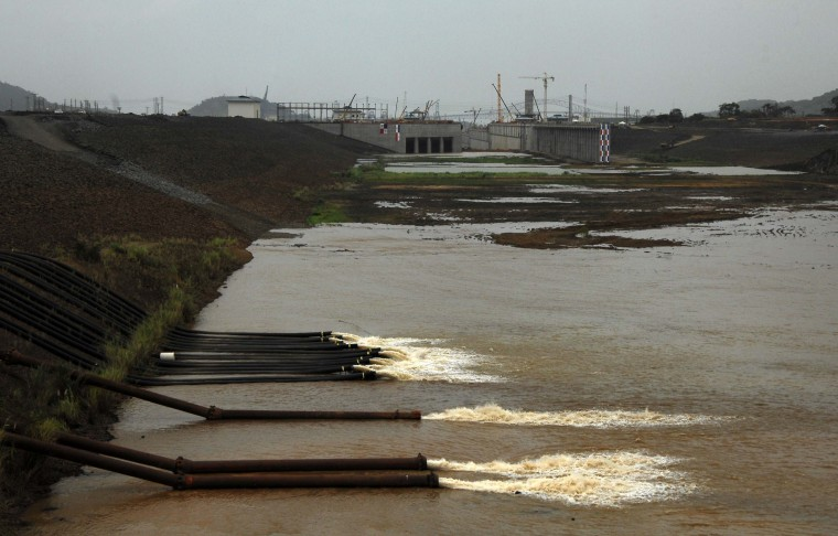 The water of the Miraflores Lake goes through the piping of the new locks in Cocoli, 7 km from Panama City on June 22, 2015. The last lock of the new Panama Canal started to be filled Monday as the equipment is ready to be tested before its launch on 2016. (Ed Grimaldo/AFP/Getty Images)