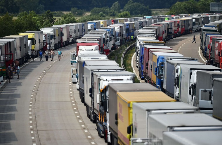 Trucks are parked on both the northbound and southbound carriageways of the M20 motorway near Ashford in Kent in south-east England, on July 1, 2015, waiting to board ferries to France as striking ferry workers blocked the port of Calais for a third consecutive day. Teams of British coastguards were deployed to hand out some 5,000 bottles of water and 750 snack meals to truck drivers stuck for hours in the long tailbacks in sweltering temperatures. (BEN STANSALL/AFP/Getty Images)