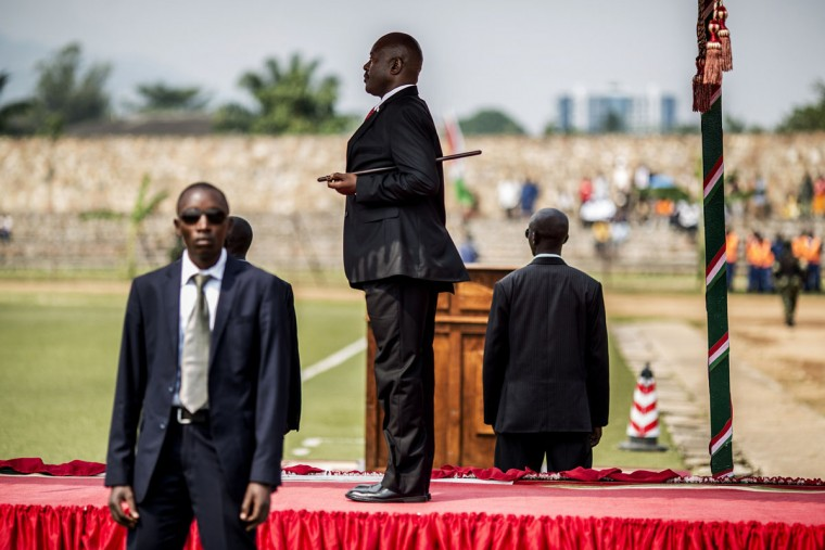 Burundi President Pierre Nkurunziza stands at attention during the national anthem at the beginning of the celebrations of the Country 53rd Independence Anniversary at the Prince Rwagasore Stadium in Bujumbura on July 1, 2015. Six people, including a policeman, were killed in gun battles on July 1 in the latest violence in Burundi, as it awaits results from elections boycotted by the opposition and condemned internationally. Elsewhere in the capital, military parades were held to mark the country's independence day. (MARCO LONGARI/AFP/Getty Images)