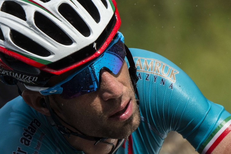 Italy's Vincenzo Nibali rides in the pack in the rain during the 166 km second stage of the 102nd edition of the Tour de France cycling race on July 5, 2015, between Utrecht and Neeltje Jans island in the Dutch city of Vrouwenpolder, in Zeeland province, The Netherlands. (Lionel Bonaventure/AFP/Getty Images)