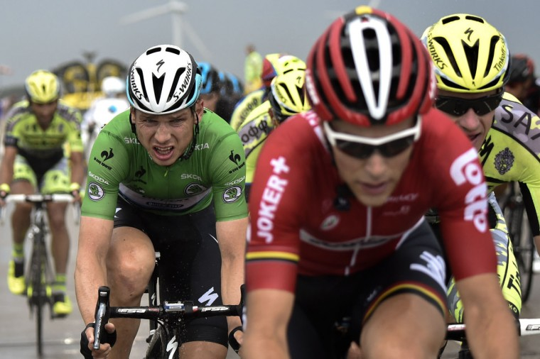 Germany's Tony Martin (L), wearing the best sprinter's green jersey, rides in the pack during the 166 km second stage of the 102nd edition of the Tour de France cycling race on July 5, 2015, between Utrecht and Neeltje Jans island in the Dutch city of Vrouwenpolder, in Zeeland province, The Netherlands. (Eric Feferberg/AFP/Getty Images)