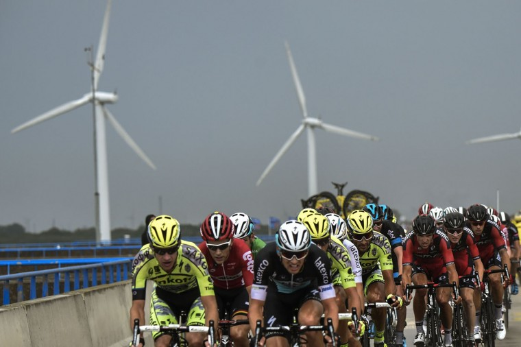 The pack rides during the 166 km second stage of the 102nd edition of the Tour de France cycling race on July 5, 2015, between Utrecht and Vrouwenpolder in Zeeland province, The Netherlands. (Eric Feferberg/AFP/Getty Images)