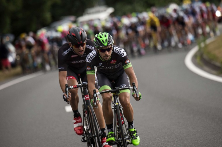 (From L) Czech Republic's Jan Barta and France's Armindo Fonseca ride in a breakaway during the 166 km second stage of the 102nd edition of the Tour de France cycling race on July 5, 2015, between Utrecht and Neeltje Jans island in the Dutch city of Vrouwenpolder, in Zeeland province, The Netherlands. (Eric Feferberg/AFP/Getty Images)