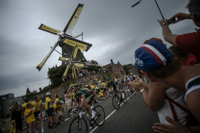 France's Thomas Voeckler rides past a windmill as supporters cheer during the 166 km second stage of the 102nd edition of the Tour de France cycling race on July 5, 2015, between Utrecht and Vrouwenpolder in Zeeland province, The Netherlands. (Lionel Bonaventure/AFP/Getty Images)