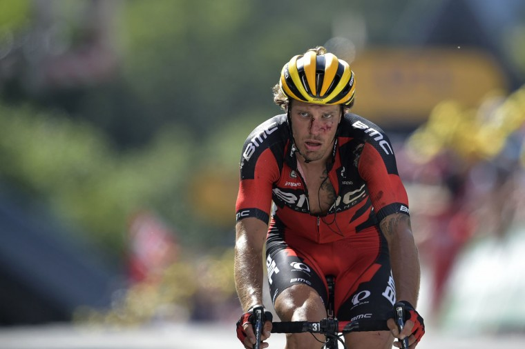 Italy's Daniel Oss, injured after a fall, reacts after crossing the finish line at the end of the 159.5 km third stage of the 102nd edition of the Tour de France cycling race on July 6, 2015, between the belgian cities of Antwerp and Huy. (AFP Photo/Lionel Bonaventure)