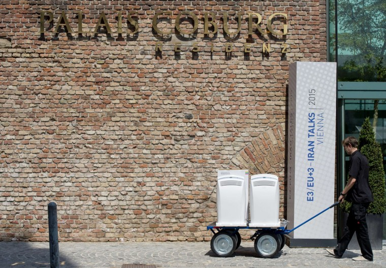 A worker brings compact air conditioners to the Palais Coburg Hotel, where the Iran nuclear talks meetings are being held, in Vienna, Austria on July 7, 2015. (JOE KLAMAR/AFP/Getty Images)