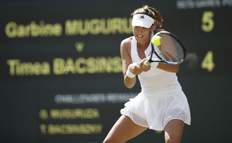 Spain's Garbine Muguruza returns against Switzerland's Timea Bacsinszky during their women's quarterfinal match on day eight of the 2015 Wimbledon Championships at The All England Tennis Club in Wimbledon, southwest London, on July 7, 2015. (ADRIAN DENNIS/AFP/Getty Images)