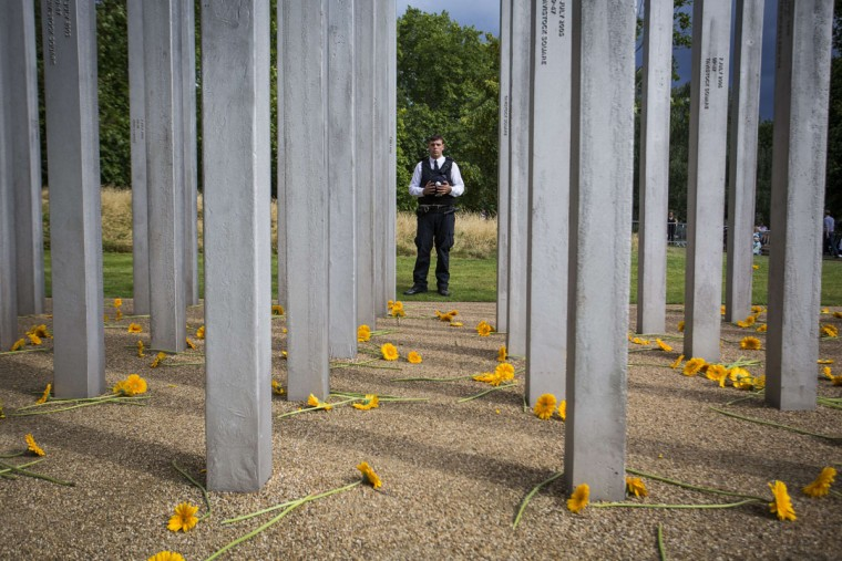 A police officer pays his respects after a service at the 7/7 memorial in London's Hyde Park on July 7, 2015, in memory of the 52 people killed during the 7/7 London bombings of 2005. (JACK TAYLOR/AFP/Getty Images)