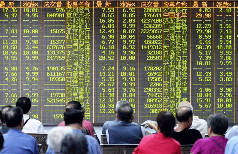 Investors sit in front of a screen showing market movements in a stock firm in Hangzhou, eastern China's Zhejiang province on July 8, 2015. China's benchmark Shanghai stock index was down more than 4.5 percent by mid-morning as additional government moves failed to shore up the tumbling market and contagion began to spread elsewhere. (CHINA OUTSTR/AFP/Getty Images)