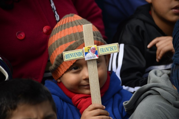 """Faithful wait for Pope Francis at the Marian National Shrine of """"El Quinche"""" in the outskirts of Quito on July 8, 2015. Pope Francis, the first Latin American pontiff, heads Wednesday to Bolivia on the second leg of a three-nation tour of the continent's poorest countries, where he has been acclaimed by huge crowds. Francis will arrive in the Andean state from Ecuador, where he will wrap up his stay with a visit to a sanctuary of the Virgin of El Quinche outside the capital Quito. (JUAN CEVALLOS/AFP/Getty Images)"""