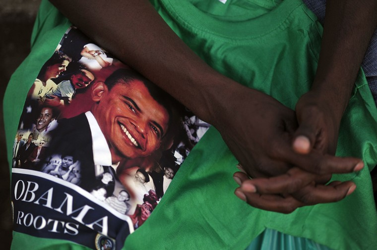 A Kenyan hawker holds a T-shirt with the image of US President Barrack Obama and the words written in the Luo language, 'Nonro Mar Obama' meaning 'Arrangements for Obama visit ' to motorists during the Luo cultural festival, on July 11, 2015, in Nairobi. The Luo festival which is the tribe that Obama's family belongs to, comes weeks ahead of US President Barrack Obama's visit to Kenya. President Obama's visit, is his first visit to his father's homeland since becoming the president of the USA. (SIMON Maina/AFP/Getty Images)A Kenyan hawker holds a T-shirt with the image of US President Barrack Obama and the words written in the Luo language, 'Nonro Mar Obama' meaning 'Arrangements for Obama visit ' to motorists during the Luo cultural festival, on July 11, 2015, in Nairobi. The Luo festival which is the tribe that Obama's family belongs to, comes weeks ahead of US President Barrack Obama's visit to Kenya. President Obama's visit, is his first visit to his father's homeland since becoming the president of the USA. (SIMON Maina/AFP/Getty Images)