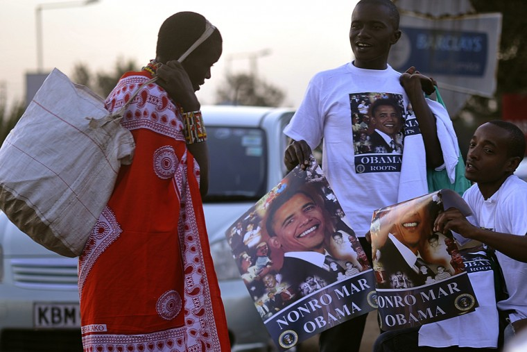 A Maasai woman looks at hawkers selling a poster of US President Barrack Obama and the words written in the Luo language, 'Nonro Mar Obama' meaning 'Arrangements for Obama visit ' to motorists during the Luo cultural festival, on July 11, 2015, in Nairobi. The Luo festival which is the tribe that Obama's family belongs to, comes weeks ahead of US President Barrack Obama's visit to Kenya. President Obama's visit, is his first visit to his father's homeland since becoming the president of the USA. (Simon Maina/AFP/Getty Images)
